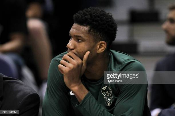 Giannis Antetokounmpo of the Milwaukee Bucks looks on from the bench in the second quarter against the Detroit Pistons during a preseason game at BMO...