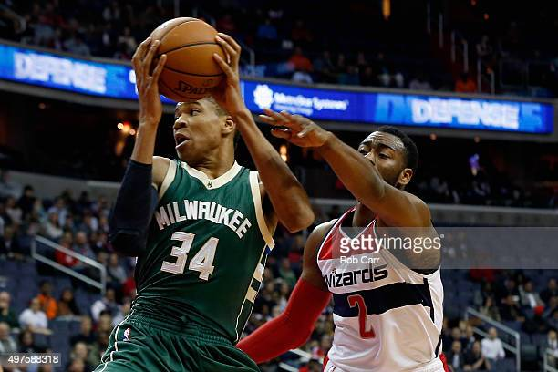 Giannis Antetokounmpo of the Milwaukee Bucks looks to pass in front of John Wall of the Washington Wizards in the first half at Verizon Center on...