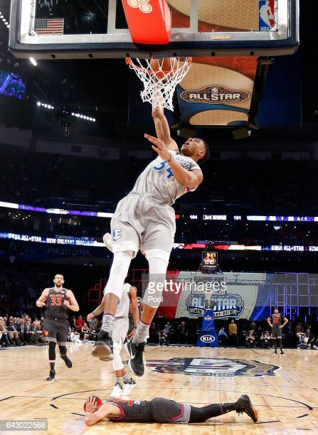 Giannis Antetokounmpo of the Milwaukee Bucks makes the slam dunk as Stephen Curry of the Golden State Warriors lays on the court during the 2017 NBA...