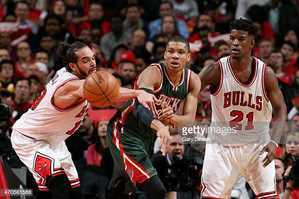 Giannis Antetokounmpo of the Milwaukee Bucks passes the ball against Joakim Noah and Jimmy Butler of the Chicago Bulls in Game Two of the Eastern...