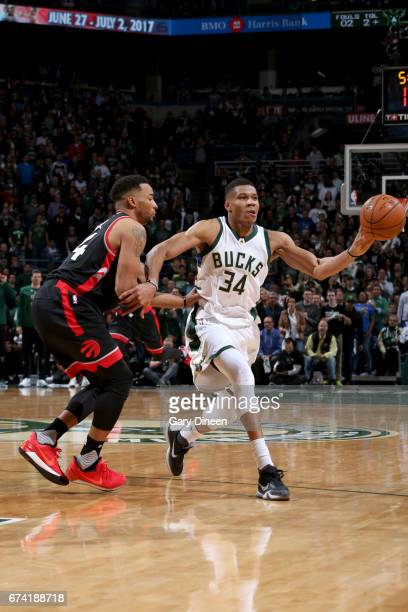 Giannis Antetokounmpo of the Milwaukee Bucks passes the ball against the Toronto Raptors during Game Six of the Eastern Conference Quarterfinals of...