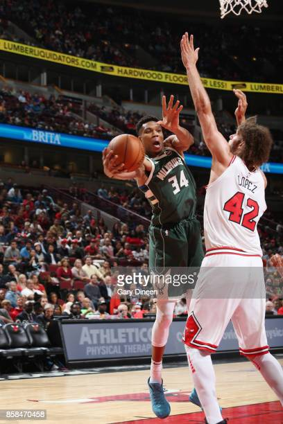 Giannis Antetokounmpo of the Milwaukee Bucks passes the ball against the Chicago Bulls during the preseason game on October 6 2017 at the United...