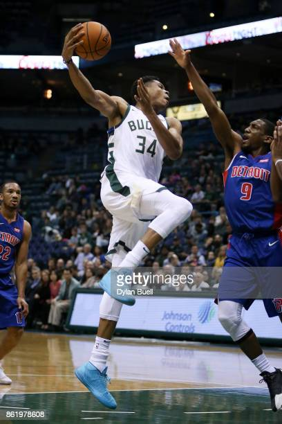 Giannis Antetokounmpo of the Milwaukee Bucks passes the ball while being guarded by Langston Galloway of the Detroit Pistons in the first quarter...