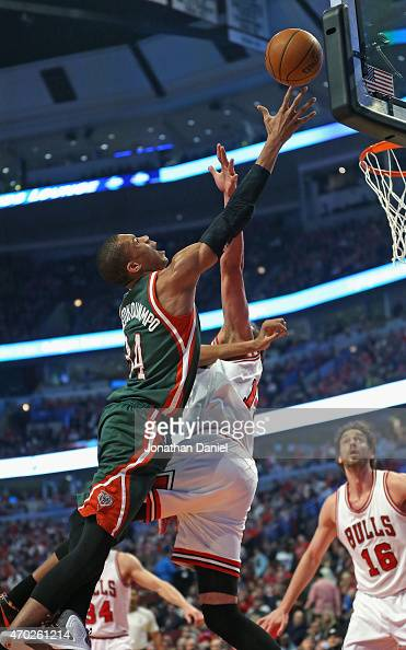Giannis Antetokounmpo of the Milwaukee Bucks puts up a shot against Joakim Noah of the Chicago Bulls during the first round of the 2015 NBA Playoffs...