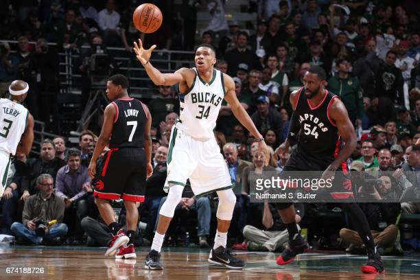Giannis Antetokounmpo of the Milwaukee Bucks receives a pass against the Toronto Raptors during Game Six of the Eastern Conference Quarterfinals of...