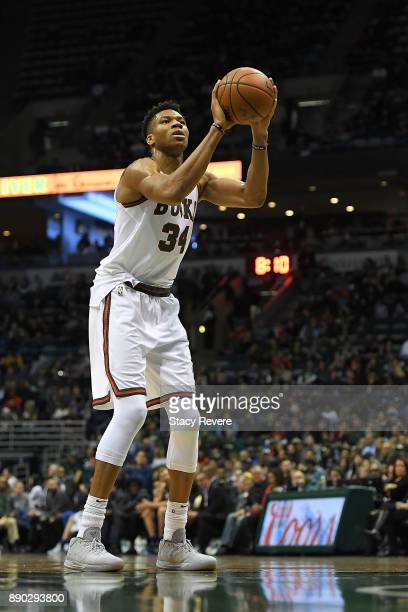 Giannis Antetokounmpo of the Milwaukee Bucks shoots a free throw during a game against the Dallas Mavericks at the Bradley Center on December 8 2017...