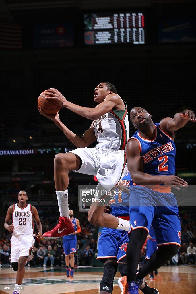 Giannis Antetokounmpo #34 of the Milwaukee Bucks shoots against Raymond Felton #2 of the New York Knicks on February 3, 2014 at the BMO Harris Bradley Center in Milwaukee, Wisconsin.