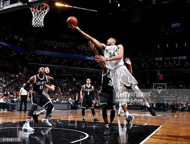Giannis Antetokounmpo of the Milwaukee Bucks shoots against the Brooklyn Nets on March 13 2016 at Barclays Center in the Brooklyn borough of New York...