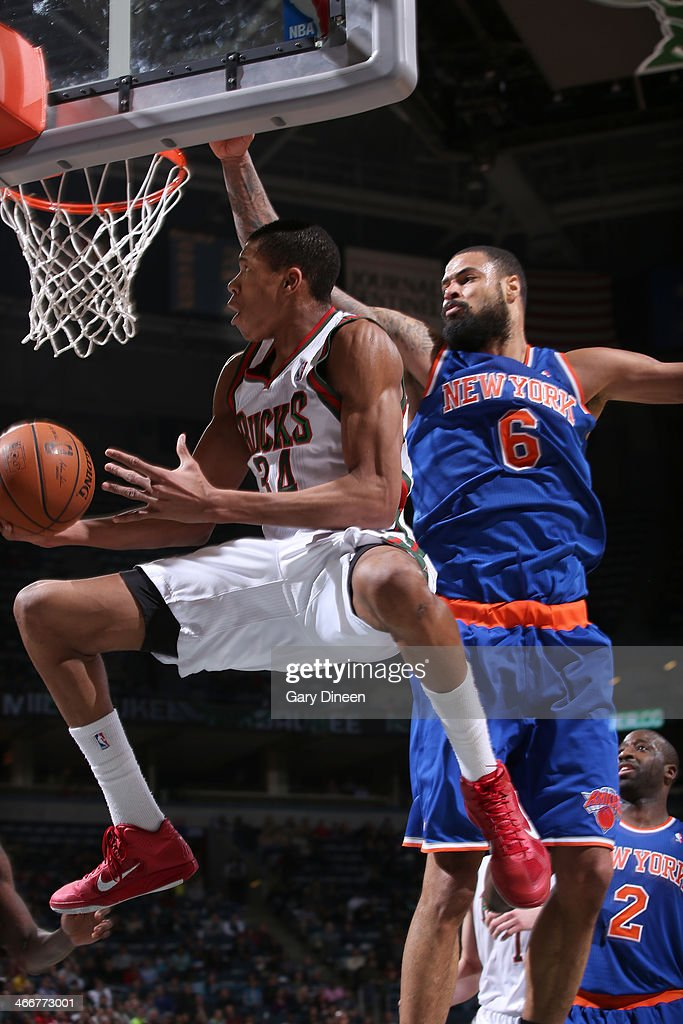 <a gi-track='captionPersonalityLinkClicked' href=/galleries/search?phrase=Giannis+Antetokounmpo&family=editorial&specificpeople=11078379 ng-click='$event.stopPropagation()'>Giannis Antetokounmpo</a> #34 of the Milwaukee Bucks shoots against <a gi-track='captionPersonalityLinkClicked' href=/galleries/search?phrase=Tyson+Chandler&family=editorial&specificpeople=202061 ng-click='$event.stopPropagation()'>Tyson Chandler</a> #6 of the New York Knicks on February 3, 2014 at the BMO Harris Bradley Center in Milwaukee, Wisconsin.