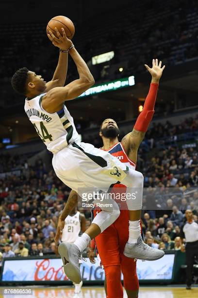 Giannis Antetokounmpo of the Milwaukee Bucks shoots over Markieff Morris of the Washington Wizards during the first half of a game at the Bradley...