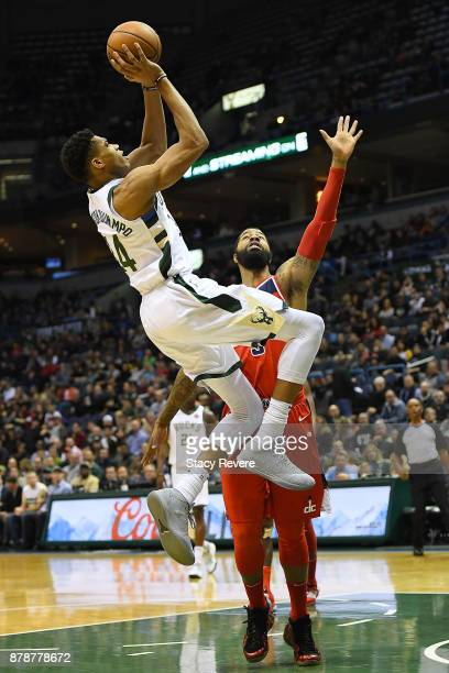 Giannis Antetokounmpo of the Milwaukee Bucks shoots over Markieff Morris of the Washington Wizards during a game at the Bradley Center on November 20...