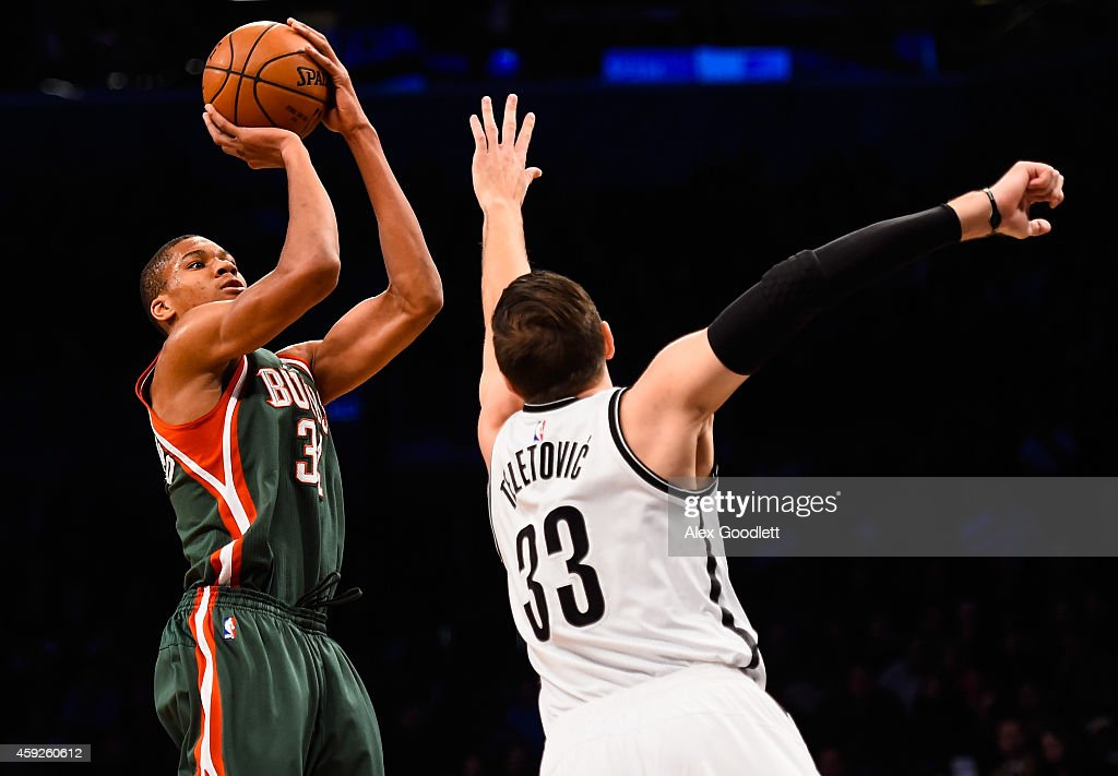 Giannis Antetokounmpo of the Milwaukee Bucks shoots over Mirza Teletovic of the Brooklyn Nets in the first quarter at the Barclays Center on November...