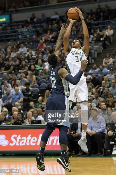 Giannis Antetokounmpo of the Milwaukee Bucks shoots over Tyreke Evans of the Memphis Grizzlies during a game at the Bradley Center on November 13...