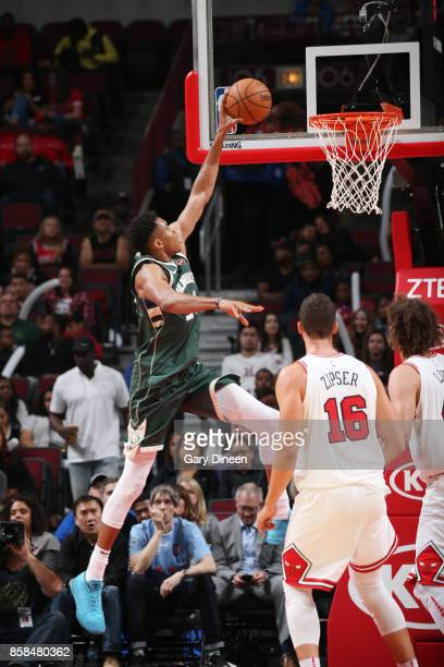 Giannis Antetokounmpo of the Milwaukee Bucks shoots the ball against the Chicago Bulls during the preseason game on October 6 2017 at the United...