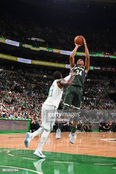 Giannis Antetokounmpo of the Milwaukee Bucks shoots the ball against the Boston Celtics on October 18 2017 at the TD Garden in Boston Massachusetts...