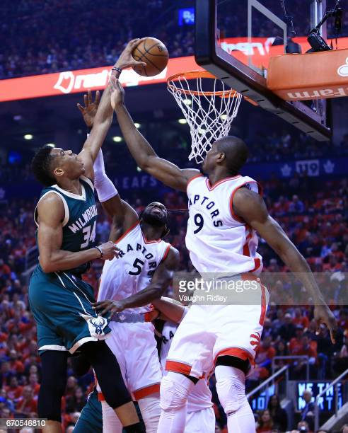 Giannis Antetokounmpo of the Milwaukee Bucks shoots the ball as DeMarre Carroll and Serge Ibaka of the Toronto Raptors defend in the first half of...