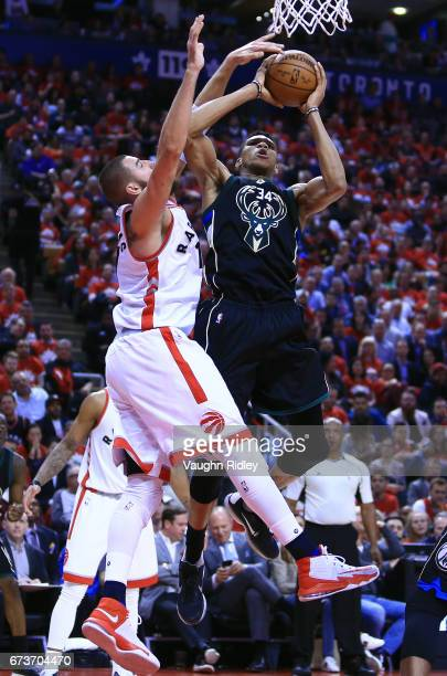 Giannis Antetokounmpo of the Milwaukee Bucks shoots the ball as Jonas Valanciunas of the Toronto Raptors defends in the second half of Game Five of...