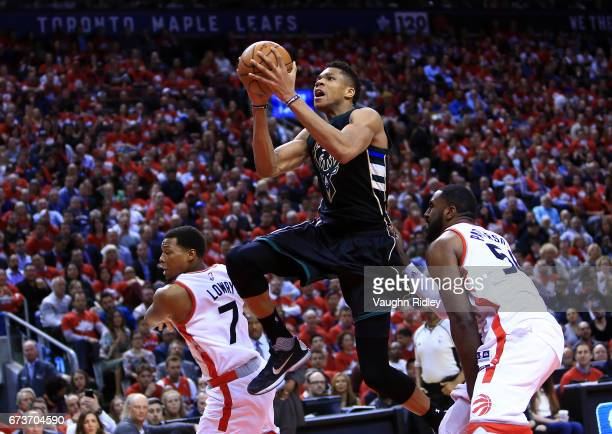 Giannis Antetokounmpo of the Milwaukee Bucks shoots the ball as Patrick Patterson of the Toronto Raptors defends in the second half of Game Five of...