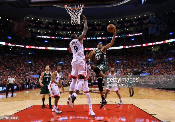 Giannis Antetokounmpo of the Milwaukee Bucks shoots the ball as Serge Ibaka of the Toronto Raptors defends in the second half of Game Two of the...