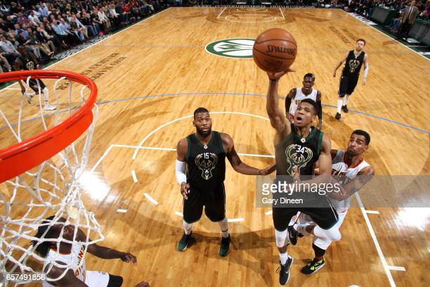 Giannis Antetokounmpo of the Milwaukee Bucks shoots the ball during the game against the Atlanta Hawks on March 24 2017 at the BMO Harris Bradley...