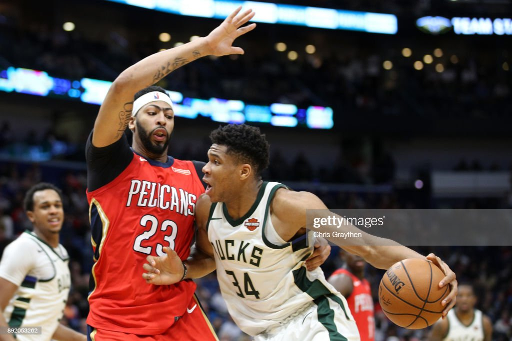 Giannis Antetokounmpo #34 of the Milwaukee Bucks shoots the ball over Anthony Davis #23 of the New Orleans Pelicans at Smoothie King Center on December 13, 2017 in New Orleans, Louisiana.