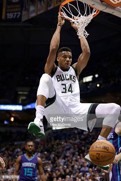 Giannis Antetokounmpo of the Milwaukee Bucks slam dunks the basketball during the first quarter against the Charlotte Hornets at BMO Harris Bradley...