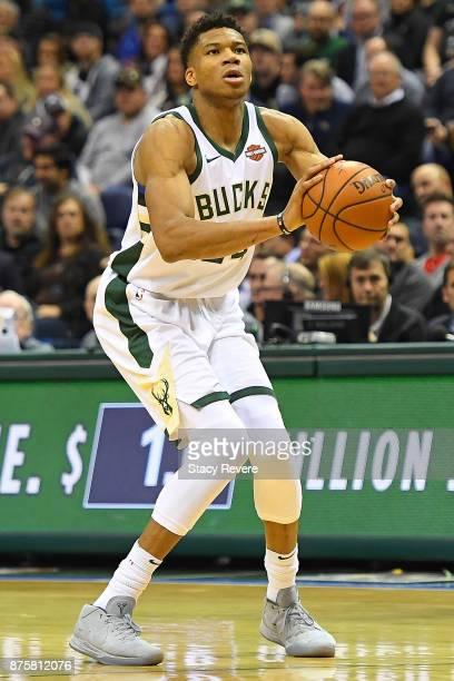 Giannis Antetokounmpo of the Milwaukee Bucks takes a shot during a game against the Detroit Pistons at the Bradley Center on November 15 2017 in...
