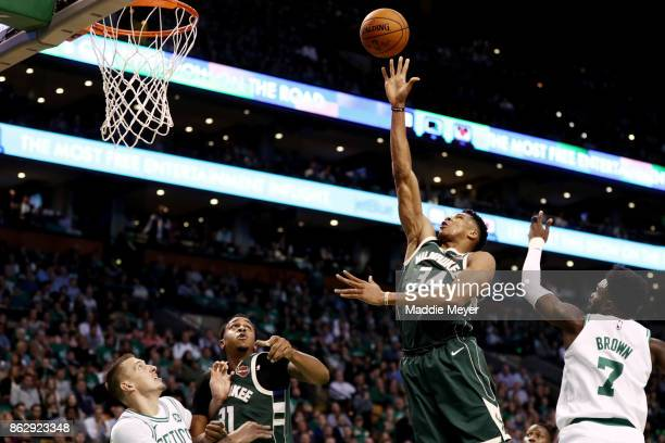 Giannis Antetokounmpo of the Milwaukee Bucks takes a shot over Jaylen Brown of the Boston Celtics during the second quarter at TD Garden on October...