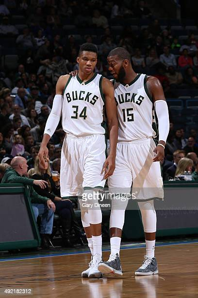 Giannis Antetokounmpo of the Milwaukee Bucks talks with teammate Greg Monroe during the game against the Detroit Pistons on October 10 2015 at the...