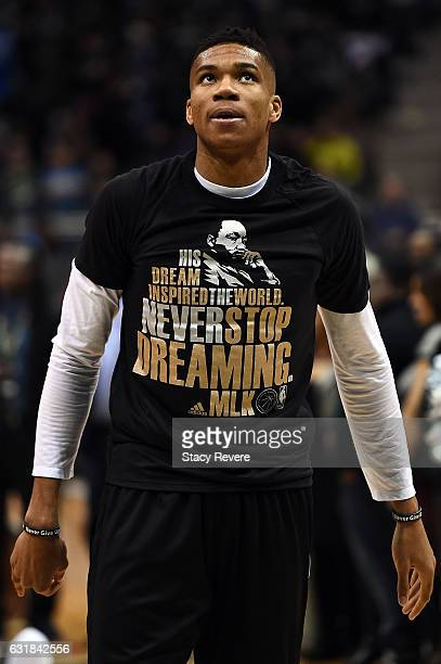 Giannis Antetokounmpo of the Milwaukee Bucks wears a tshirt honoring Dr Martin Luther King prior to a game against the Philadelphia 76ers at BMO...
