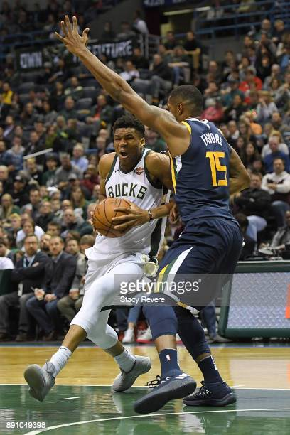 Giannis Antetokounmpo of the Milwaukee Bucks works against Derrick Favors of the Utah Jazz during a game at the Bradley Center on December 9 2017 in...