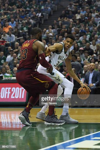 Giannis Antetokounmpo of the Milwaukee Bucks works against LeBron James of the Cleveland Cavaliers during the first quarter of a game at the Bradley...