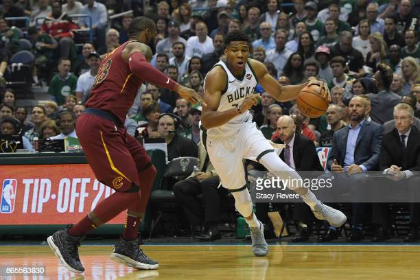Giannis Antetokounmpo of the Milwaukee Bucks works against LeBron James of the Cleveland Cavaliers during a game at the Bradley Center on October 20...