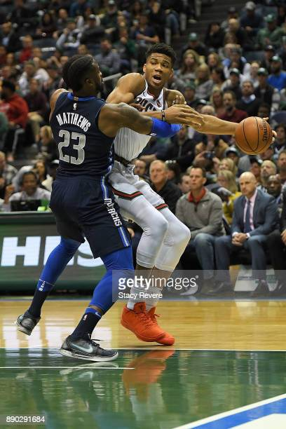 Giannis Antetokounmpo of the Milwaukee Bucks works against Wesley Matthews of the Dallas Mavericks during a game at the Bradley Center on December 8...