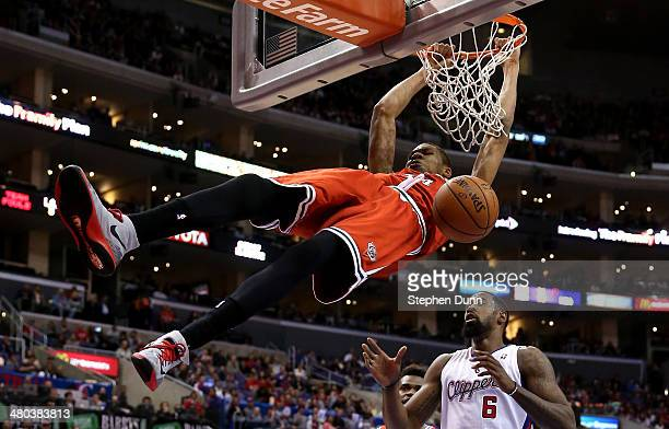 Giannis Antetokounmpo of the Milwaukee Bucksdunks over DeAndre Jordan of the Los Angeles Clippers at Staples Center on March 24 2014 in Los Angeles...