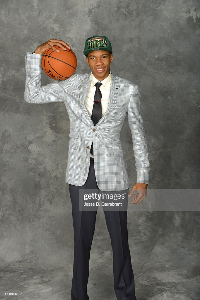 Giannis Antetokounmpo poses for a portrait after being selected number 15th overall by the Minnesota Timberwolves during the 2013 NBA Draft at the Barclays Center on June 27, 2013 in Brooklyn, New York.