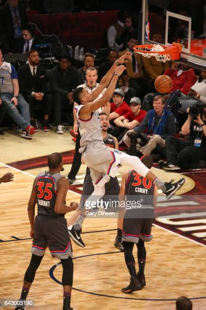 Giannis Antetokounmpo#34 of the Eastern Conference dunks against Klay Thompson and Stephen Curry of the Western Conference during NBA AllStar Game as...