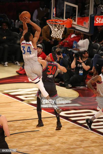 Giannis Antetokounmpo#34 of the Eastern Conference dunks against Stephen Curry of the Western Conference during NBA AllStar Game as part of the 2017...