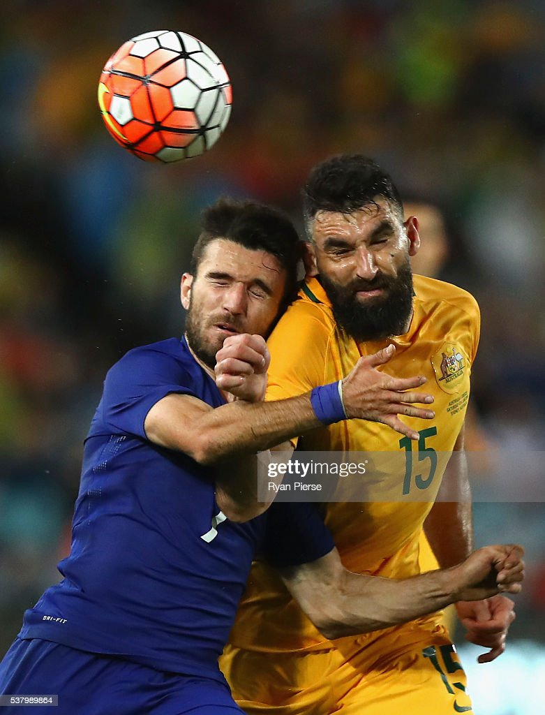 Giannis Gianniotas of Greece competes for the ball against Mile Jedinak of Australia during the international friendly match between the Australian Socceroos and Greece at ANZ Stadium on June 4, 2016 in Sydney, Australia.