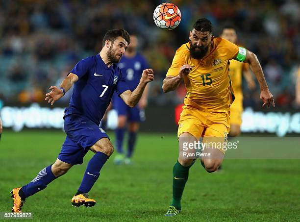 Giannis Gianniotas of Greece competes for the ball against Mile Jedinak of Australia during the international friendly match between the Australian...