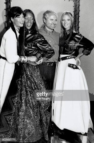 Gianni's girls Gianni Versace poses with some of his favorite supermodels at his palazzo Left to right Linda Evangelista Naomi Campbell and Christy...