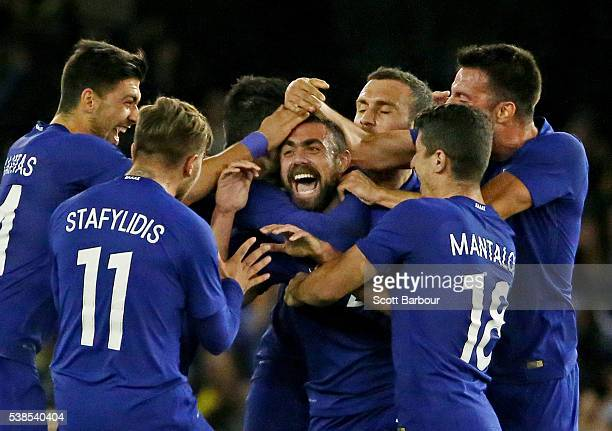 Giannis Maniatis of Greece is congratulated by his teammates after kicking a goal from half way during the International Friendly match between the...