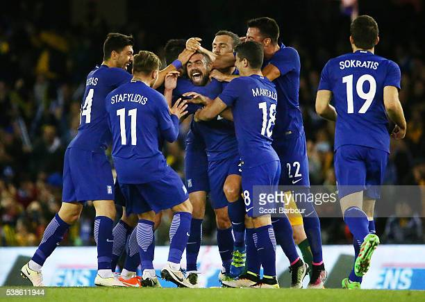 Giannis Maniatis of Greece is congratulated by his teammates after kicking a goal from past half way during the International Friendly match between...