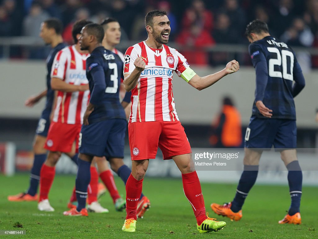 Giannis Maniatis of Olympiacos FC celebrates at the final whistle during the UEFA Champions League Round of 16 match between Olympiacos FC and Manchester United at Karaiskakis Stadium on February 25, 2014 in Piraeus, Greece.