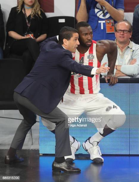 Giannis Sfairopoulos Head Caoch of Olympiacos Piraeus talks with Patric Young #4 of Olympiacos Piraeus during the Turkish Airlines EuroLeague Final...