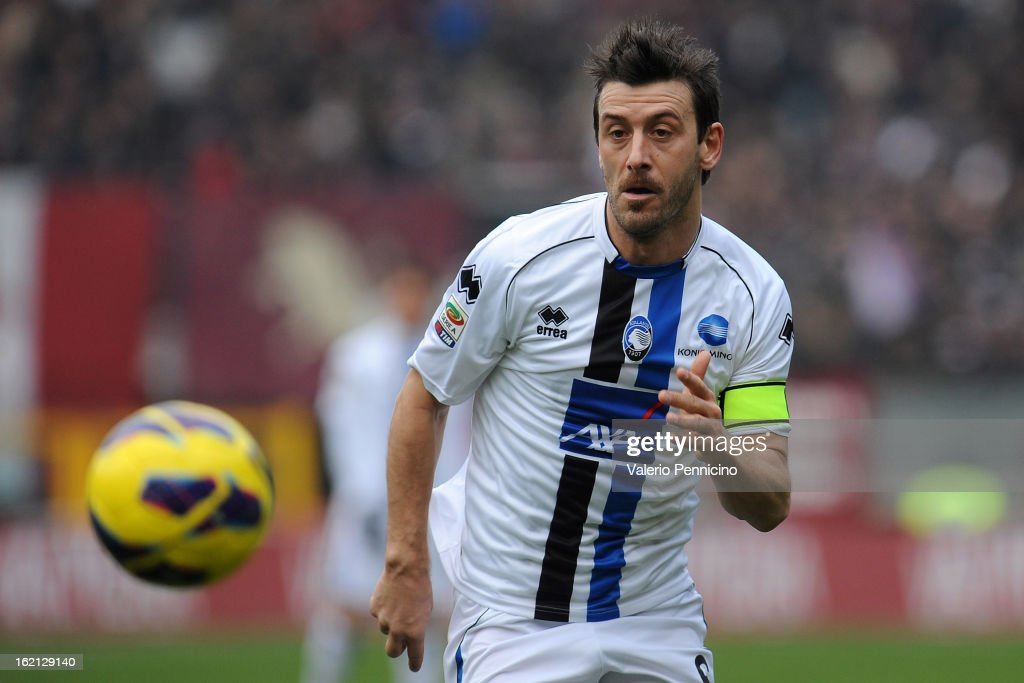 Gianpaolo Bellini of Atalanta BC in action during the Serie A match between Torino FC and Atalanta BC at Stadio Olimpico di Torino on February 17, 2013 in Turin, Italy.