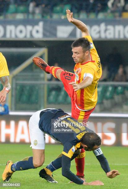 Gianpaolo Pazzini of Hellas Verona FC competes with Ledian Memishaj of Benevento Calcio during the Serie A match between Hellas Verona FC and...