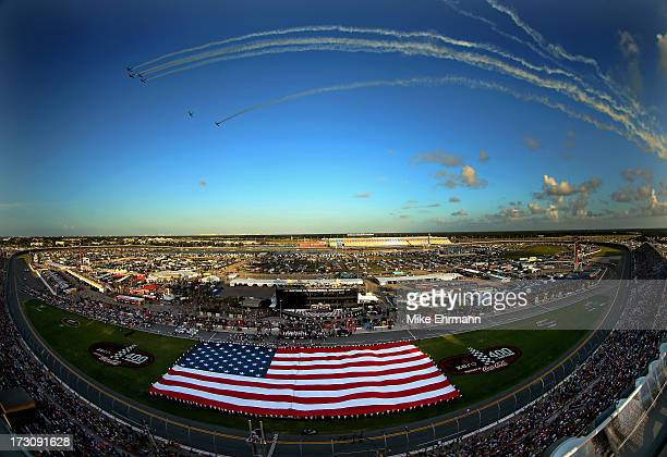 A giant American Flag is stretched across the infield during the performance of the National Anthem during the NASCAR Sprint Cup Series Coke Zero 400...