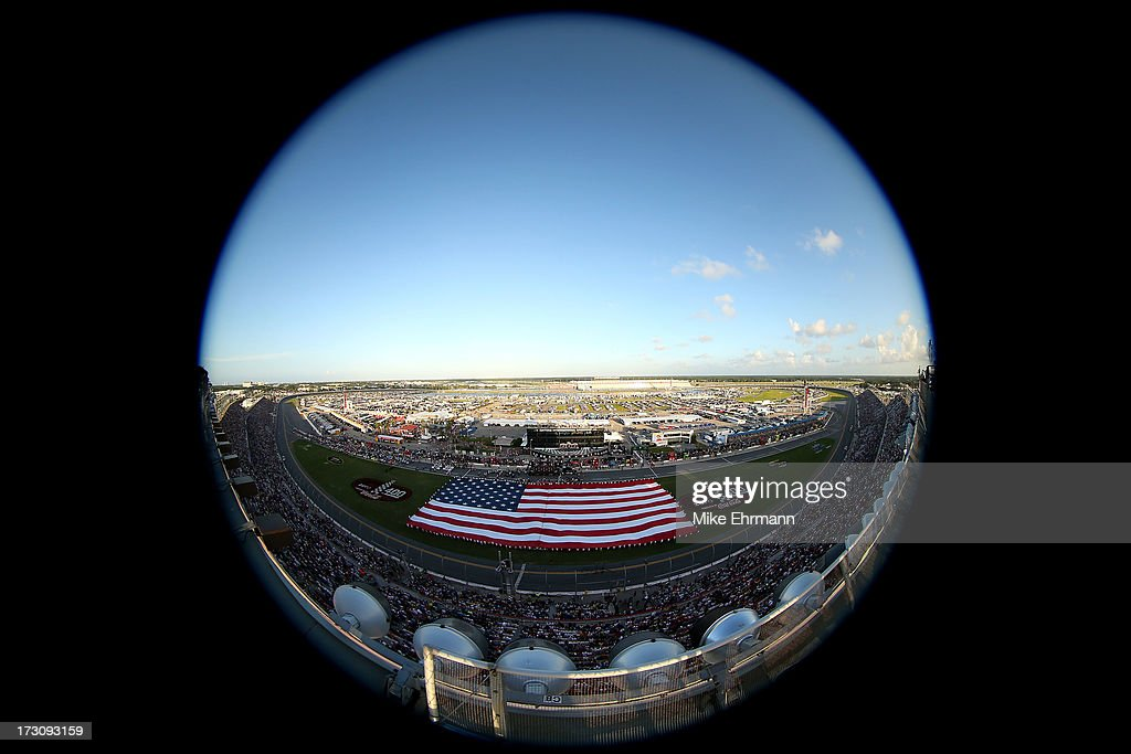 A giant American Flag is stretched across the infield during the performance of the National Anthem the NASCAR Sprint Cup Series Coke Zero 400 at Daytona International Speedway on July 6, 2013 in Daytona Beach, Florida.