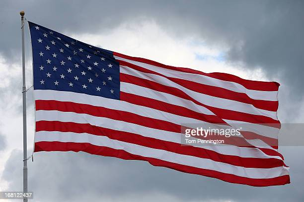 A giant American Flag waves above the track during the NASCAR Sprint Cup Series Aaron's 499 at Talladega Superspeedway on May 5 2013 in Talladega...